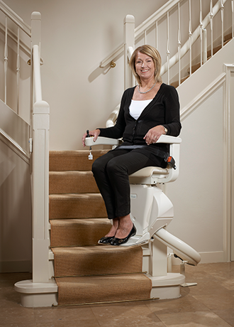 woman_on_moving_stairlift.png